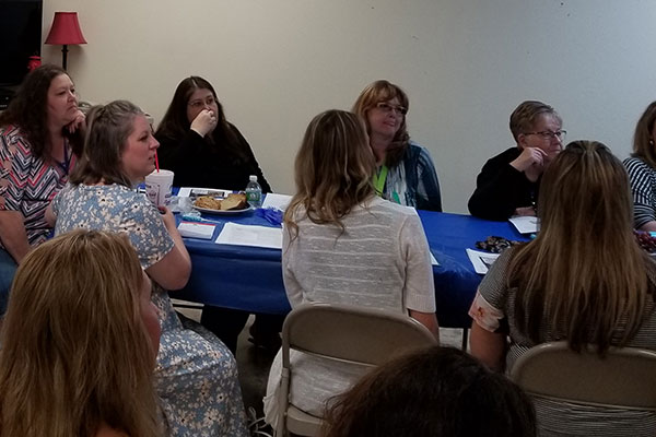 group of people in a meeting - washington county health coalition